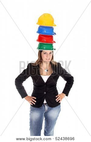 modern architect woman with lots of helmets