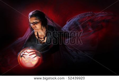 The fortuneteller with a sphere
