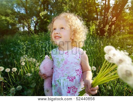 Little girl with dandelions.