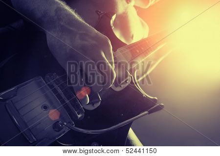 man playing electrical guitar in black and yellow