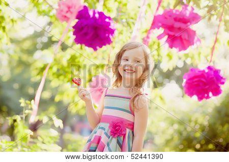 girl celebrating birthday in park