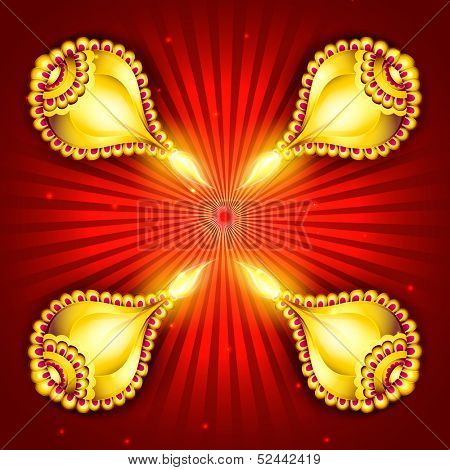 Illuminated golden oil lit lamps on red background for occasion of Indian festival of lights, Shubh Deepawali (Happy Deepawali).