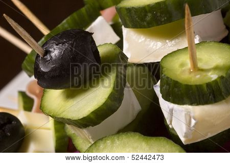Cheese and cucumber some ham on sticks