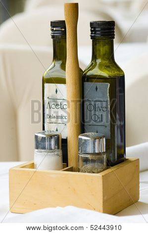 Olive oil and vinegar in a restaurant with white cover