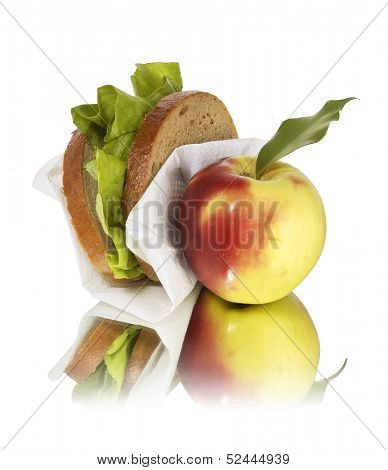 school lunch apple and sandwich
