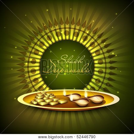 Indian festival of lights, Shubh Deepawali (Happy Deepawali) greeting card with illuminated oil lit lamps and golden coins for worship on shiny green abstract background.