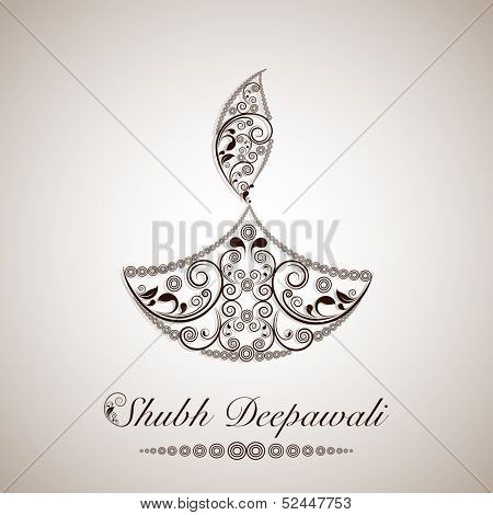 Creative floral decorated oil lit lamp on abstract grey background for Indian festival of lights, Shubh Deepawali (Happy Deepawali).