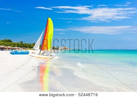 Scene with sailing boat at the famous Varadero beach , Caribbean sea in Cuba