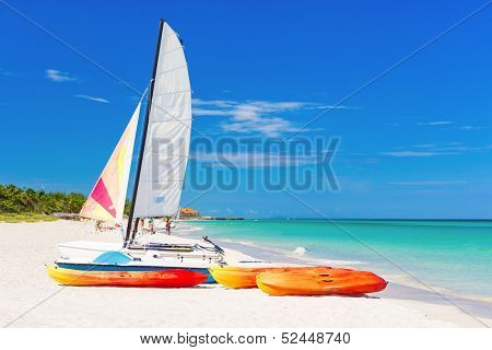 Sailing boat (catamaran) and kayaks at Varadero beach in Cuba