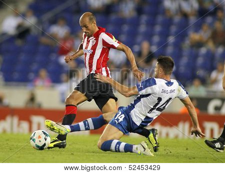 BARCELONA - SEP, 23: Mikel Rico(L) of Athletic Bilbao vies with David Lopez(R) of RCD Espanyol during a Spanish League match at the Estadi Cornella on September 23, 2013 in Barcelona, Spain