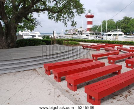 Harbor Town Lighthouse With Red Benches On Hilton Head Island South Carolina