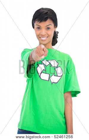 Cute black haired ecologist pointing at camera with her finger on white background