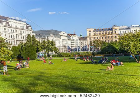 Public Green Area Sigmund Freud Platz,, Lawn For Sunbathing Is Used By People From Vienna