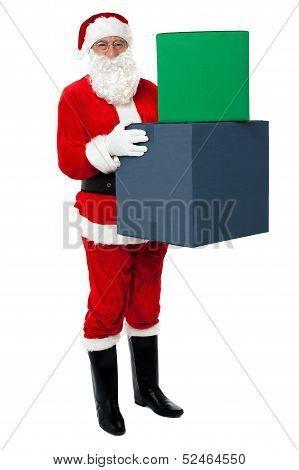 Photo Of Happy Santa Claus Delivering Gifts