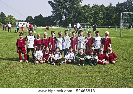 Young Soccer Player Pose Proud For Team Photo