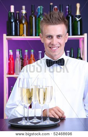 Bartender holding tray with champagne glasses
