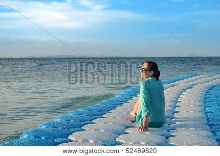 Girl sitting on the dock
