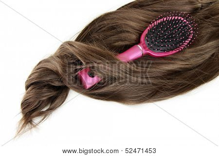 Shiny brown hair with comb isolated on white