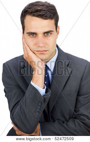 Concentrated businessman looking at camera on white background