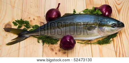 Whole Round Fish Yellowtail And Three Red Onions