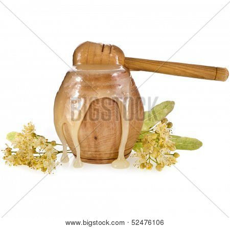 linden honey  flowing in birch barrel and honey stick isolated on white background
