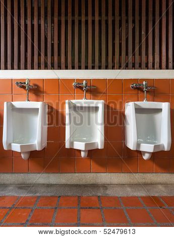 Three Urinal In Public Toilet
