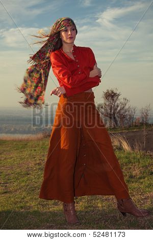 young blond woman in autumn fashion clothes,  red leather jacket, cashmere scarf and brown skirt outdoor shot