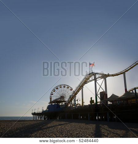 Santa Monica pier Ferris Wheel at sunset in California USA