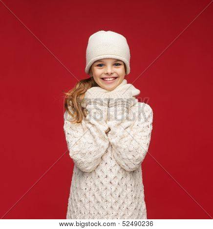 winter, people, happiness concept - girl in hat, muffler and gloves