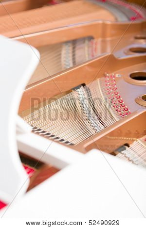 Close up of piano chords. Concept of music and art