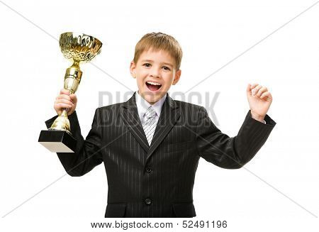 Half-length portrait of little business man handing golden cup and happy gesturing, isolated on white. Concept of leadership and success