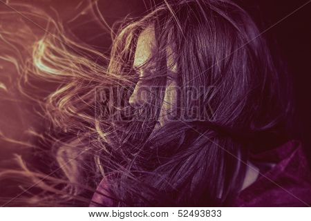 Photo of young beautiful lady with magnificent dark hair, autumn toned