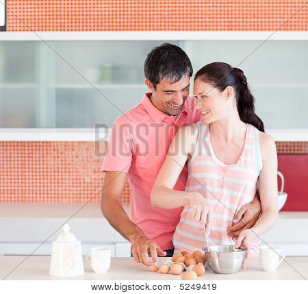 Two Lovers Cooking At Home