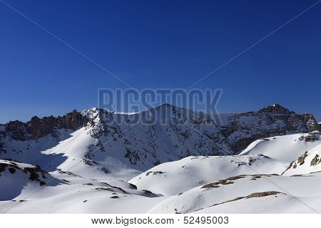 Snowy Mountains And Blue Sky In Morning