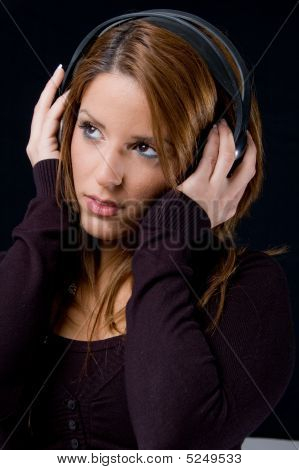 Portrait Of Young Woman Listening Music