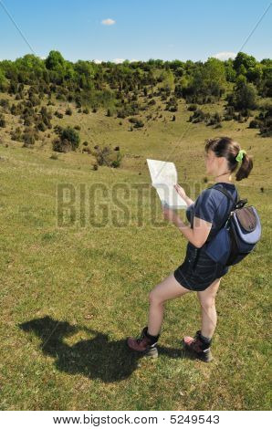 Young Woman Looking Into Map