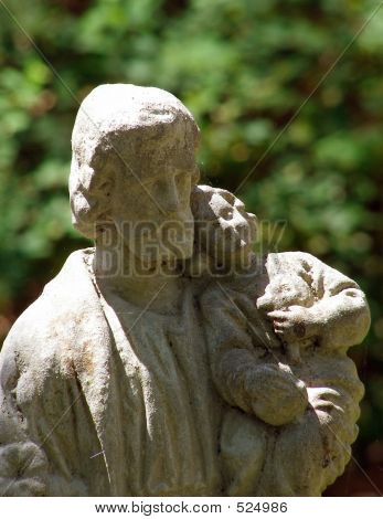 Statue Of Jesus Holding A Child