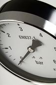 foto of barometer  - industrial barometer extreme close up white background - JPG