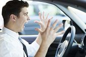 picture of irritated  - Frustrated man driving car - JPG