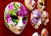 stock photo of eye-sockets  - A couple of handmade carnival masks in red plush - JPG