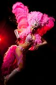 stock photo of brazilian carnival  - cabaret dancer over dark background - JPG