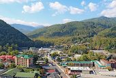 picture of gatlinburg  - Downtown Gatlinburg Tennessee viewed from above looking towards Smoky Mountains National Park - JPG