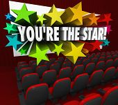 The words You're the Star exploding out of a movie theatre screen to illustrate celebrity and being