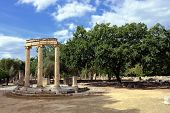 stock photo of olympic-games  - Greece Olympia ancient ruins of the important Philippeion in Olympia birthplace of the olympic games  - JPG