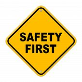 Large beveled yellow safety first road sign with rivets on a white background