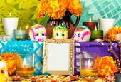 foto of sugar skulls  - Traditional mexican day of the dead altar with sugar skulls candles and blank photo frame - JPG