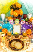 stock photo of altar  - Traditional mexican day of the dead altar with blank photo frame sugar skulls cempasuchil flowers candles and cookies - JPG