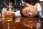 pic of over counter  - Drunk and unconscious businessman lying on a counter in a classy bar - JPG