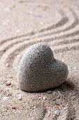 foto of pumice stone  - Grey zen stone in shape of heart - JPG