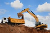 pic of rear-end  - Excavator loading sand in rear - JPG